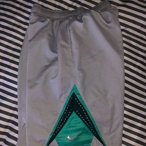 Grey and teal boys Nike shorts size Large